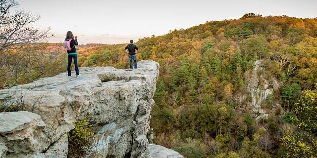 A man and woman on the King and Queen Seat rock formation at Rocks State Park in Maryland. (Edwin Remsburg/VW Pics via Getty Images, File)