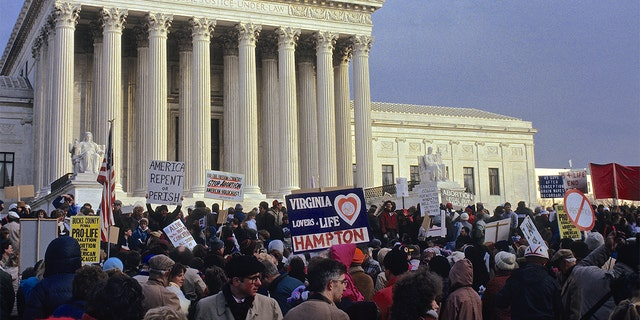 The annual March for Life protest in front of the US Supreme Court in 1991. The March for Life is an annual pro-life rally protesting abortion, held in Washington, D.C., on or around the anniversary of the United States Supreme Court's decision legalizing abortion in the case Roe v. Wade. (Photo by Mark Reinstein/Corbis via Getty Images)