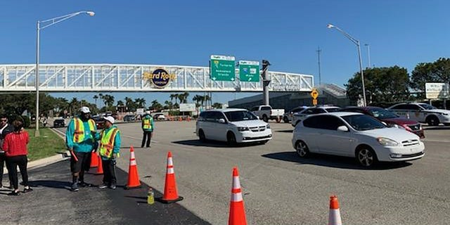 Fans driving down the Florida Turnpike began showing up at the Hard Rock Stadium early Sunday.