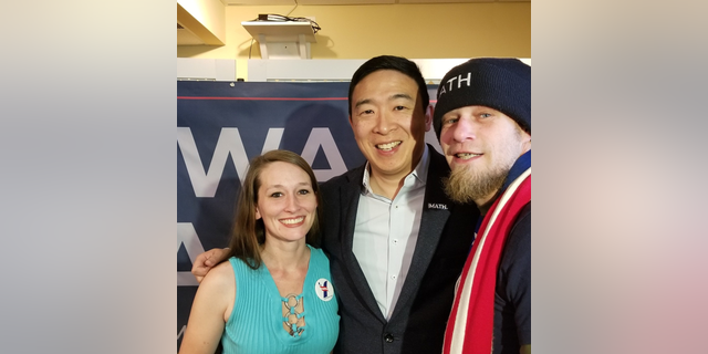Russell Peterson and his wife Elasa pose for a picture with Andrew Yang. (Photo provided by Russell Peterson)