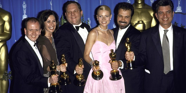 Miramax Films executive Harvey Weinstein (3rd L) and actress Gwyneth Paltrow (3R) w. producers of Shakespeare in Love holding their Oscars in Press Room at Academy Awards.