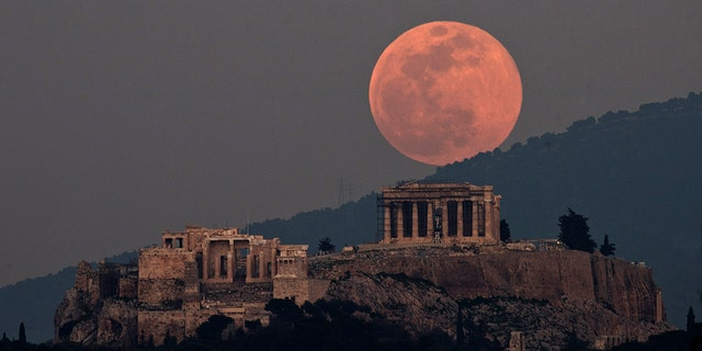The moon rises over the Parthenon on the ancient Acropolis Hill in Athens, Greece, Tuesday, Feb. 19, 2019. The full moon, or supermoon, appears brighter and bigger than other full moons because it is close to its perigee, which is the closest point in its orbit to Earth.