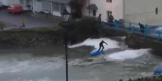 Surfers can be seen in Cornwall on Sunday.
