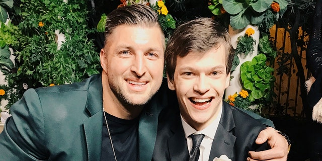 Micah Fowler and Tim Tebow at Zoe Church's 'Night to Shine' on Feb 8th, 2019.