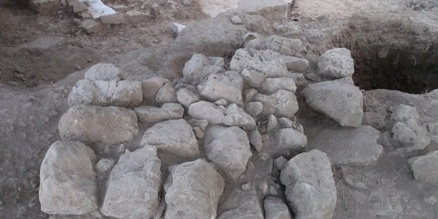 Ancient stone altar and refuse pit at the site. (Tel Aviv University)