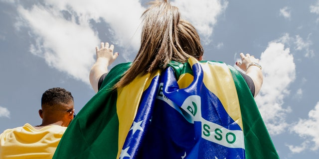 A young lady worships during The Send Brazil on Saturday, Feb. 8, 2020.