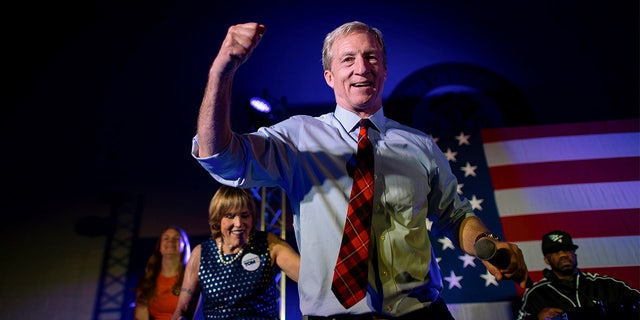 Democratic Presidential candidate entrepreneur Tom Steyer dances onstage with rapper Juvenile singing