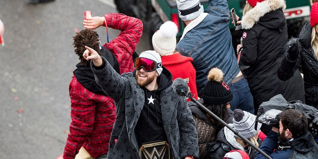 Travis Kelce of the Kansas City Chiefs points to the crowd during the Kansas City Super Bowl Parade Wednesday afternoon in Kansas City, Missouri. (Brian Davidson/Getty Images)