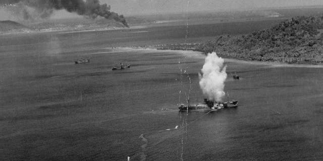 Torpedo exploding against Japanese tanker ship in Truk Lagoon during an attack by American torpedo bombers, February, 1944.