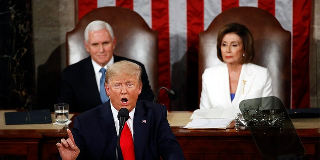 President Trump delivers his State of the Union address to a joint session of Congress on Capitol Hill in Washington, Tuesday, Feb. 4, 2020, as Vice President Mike Pence and House Speaker Nancy Pelosi, D-Calif., watch. (AP Photo/Patrick Semansky)
