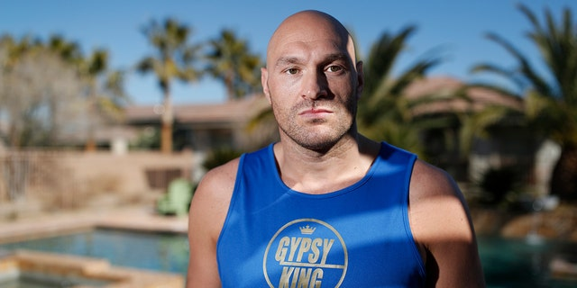 In this Thursday, Feb. 13, 2020, photo, boxer Tyson Fury poses for a portrait in Las Vegas. Fury is scheduled to fight a heavyweight rematch with WBC champion Deontay Wilder on Saturday in Las Vegas.
