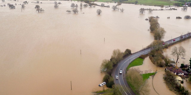 Flood water inundates fields around the town of Upton-upon-Severn, England, after the river Severn burst its banks, in the aftermath of Storm Dennis.
