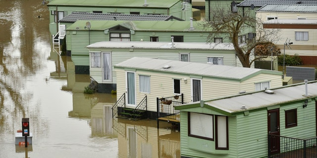 The Riverside Caravan Park is inundated by flood water after heavy rains breached the nearby river Severn and normal watercourses in the area of Bridgnorth, England, Wednesday Feb. 19, 2020.