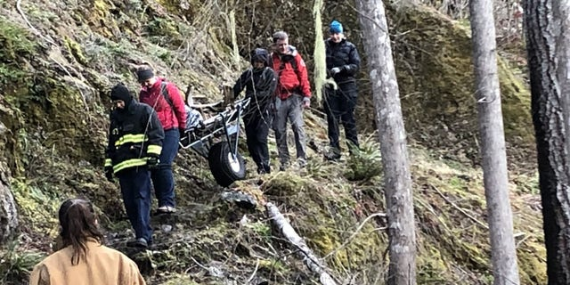 The first rescue team to reach Oldendorf had to hike about four miles up the trail.
