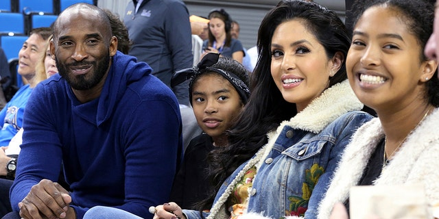 Los Angeles Lakers legend Kobe Bryant, his daughter Gianna Maria-Onore Bryant, wife Vanessa and daughter Natalia Diamante Bryant are seen before a Connecticut-UCLA NCAA women's basketball game in Los Angeles, Nov. 21, 2017.  (Associated Press)