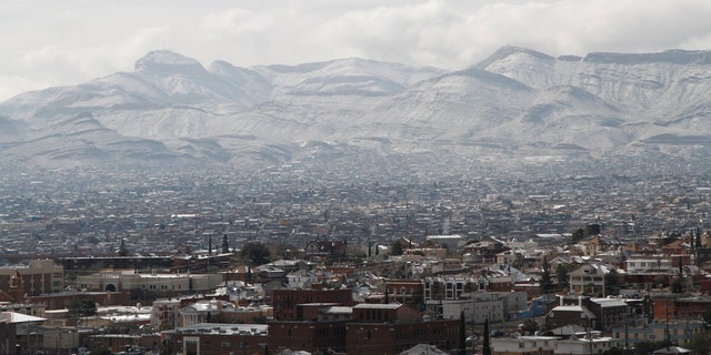 Snow obscures writing on the side of the mountains above Ciudad Juarez, Mexico, as seen from El Paso, Texas, on Wednesday, Feb. 5, 2020.