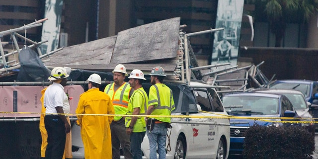 A section of scaffolding at the Four Seasons Hotel construction site in New Orleans collapsed onto at least a dozen cars Wednesday, leaving at least one person injured, as thunderstorms and high winds moved through the area.