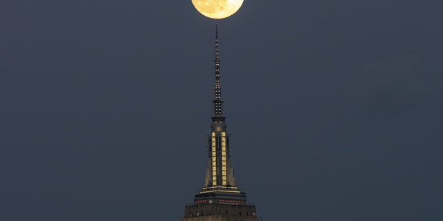Full Snow Moon rises over the Empire State Building in New York City, United States on February 8, 2020.