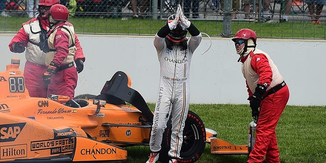 Alonso saluted the crowd after his car broke down in 2017.