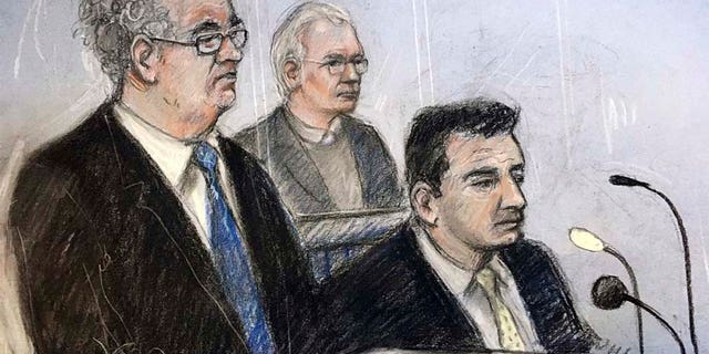 Julian Assange, center, is depicted in this court sketch alongside his lawyers, Edward Fitzgerald, on the left, and Mark Summers at Belmarsh Magistrates' Court in London on Monday. (AP)