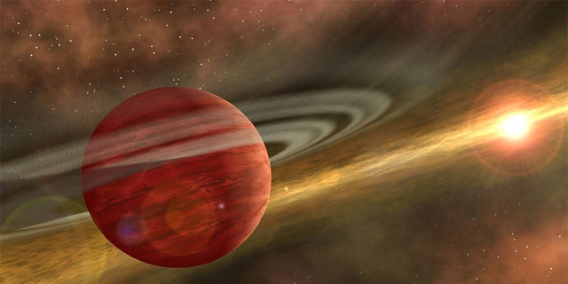Artist's conception of a massive planet orbiting a cool, young star. In the case of the system discovered by RIT astronomers, the planet is 10 times more massive than Jupiter, and the orbit of the planet around its host star is nearly 600 times that of Earth around the sun. NASA/JPL-Caltech/R. Hurt (SSC-Caltech)