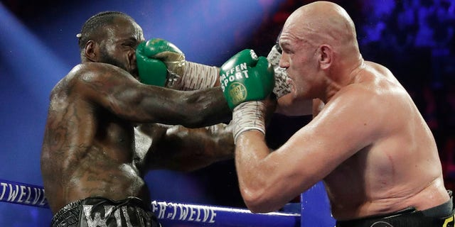 Image result for images of Tyson Fury beats Deontay Wilder in world title fight in Las Vegas