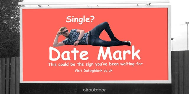 """""""Single? Date Mark. This could be the sign you've been waiting for,"""" the neon sign reads, featuring the bachelor in a playful pose."""