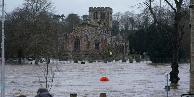 A view of a flooded street, in Appleby-in-Westmorland, as Storm Ciara hits the UK, in Cumbria, England, Sunday Feb. 9, 2020.
