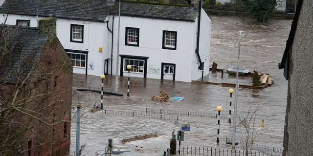 A view of a flooded street in Appleby-in-Westmorland, as Storm Ciara hits the UK, in Cumbria, England, Sunday Feb. 9, 2020.