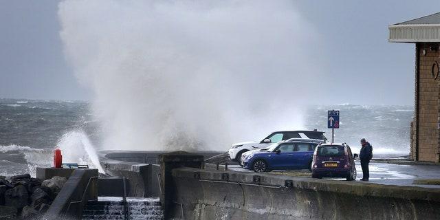 Waves batter the coastline at Saltcoats, North Ayrshire, Scotland, Sunday, Feb. 9, 2020.