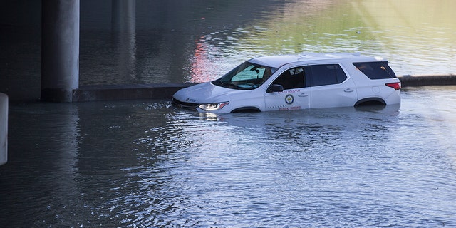 An abandoned vehicle sits stalled in floodwaters from a water main break that inundated the East Loop 610 on Thursday, Feb. 27, 2020 in Houston. (Associated Press)