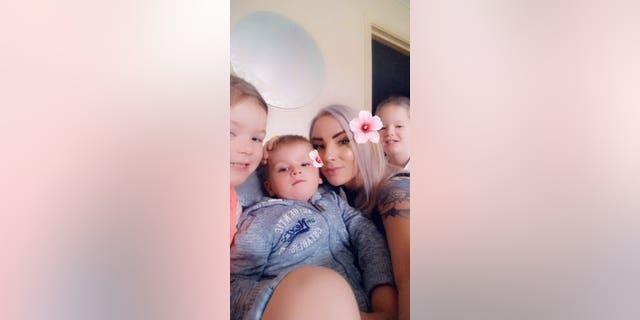 Kim Montgomery with three of her children.