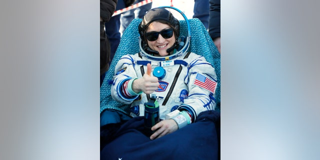 U.S. astronaut Christina Koch gestures shortly after the landing of the Russian Soyuz MS-13 space capsule about 150 km ( 80 miles) south-east of the Kazakh town of Zhezkazgan, Kazakhstan, Thursday, Feb. 6, 2020. (Sergei Ilnitsky/Pool Photo via AP)