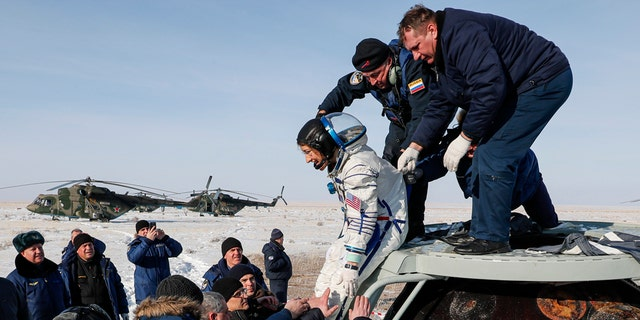 A Soyuz space capsule with U.S. astronaut Christina Koch, Italian astronaut Luca Parmitano and Russian cosmonaut Alexander Skvortsov, returning from a mission to the International Space Station landed safely on Thursday on the steppes of Kazakhstan. (Sergei Ilnitsky/Pool Photo via AP)