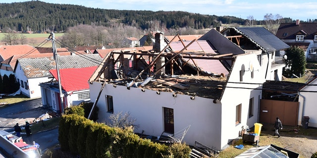 The roof of a house is damaged due to a strong storm in Rohozna, Czech Republic, Monday, Feb. 10, 2020.