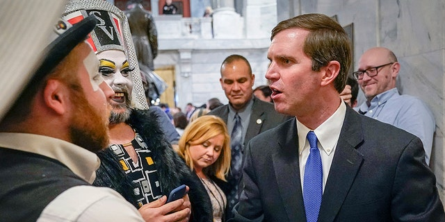 Kentucky Democratic Gov. Andy Beshear greets members of the Kentucky Order of the Sisters of Perpetual Indulgence, an LGBTQ charity group, following an LGBTQ rally at the Capitol building in Frankfort, Ky., Feb. 19, 2020. (Associated Press)