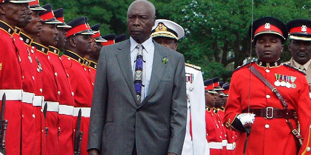 Kenya President Daniel arap Moi inspects a guard of honor at a barracks in Nairobi, Kenya during a 2002 parade by the armed forces in honor of the leader.