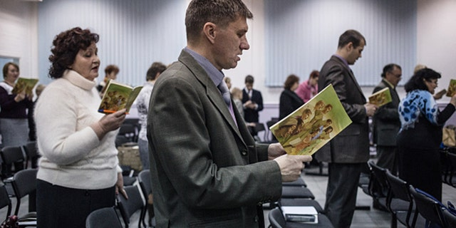 Jehovah's Witnesses sing songs at the beginning of the meeting in Rostov-on-Don. Although Rostov-on-Don is only 80 km away from Taganrog, the organization is not banned there, and people are free to gather and hold meetings. 16 Jehovah's Witnesses are accused of extremist activity in Taganrog, Russia, 80 km away from Rostov-on-Don. (Photo by Alexander Aksakov/For The Washington Post via Getty Images).