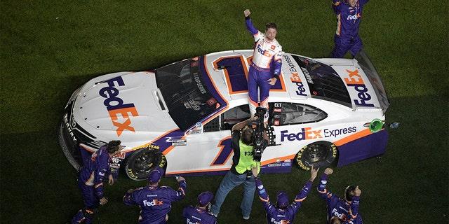 Denny Hamlin (11) celebrating in front of the grandstands. (AP Photo/Phelan M. Ebenhack)