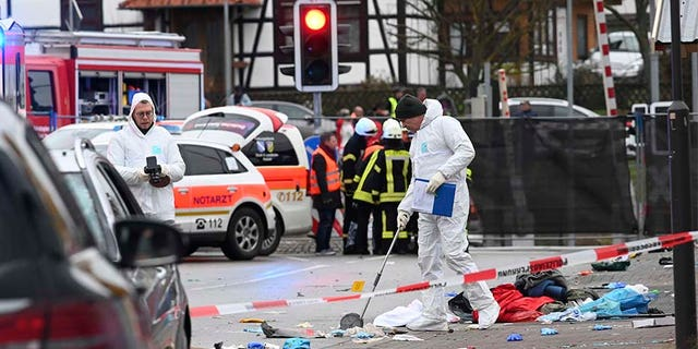 Police and rescue workers stand next to the scene of the incident in Volkmarsen, Germany, on Monday.