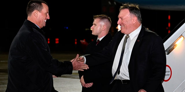Secretary of State Mike Pompeo is greeted by U.S. ambassador to Germany Richard Grenell as he arrives at Munich International Airport, in Munich, Germany on Thursday, Feb. 13, 2020.