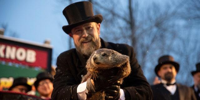 Groundhog Club co-handler Al Dereume holds Punxsutawney Phil, the weather prognosticating groundhog, during the 134th celebration of Groundhog Day on Gobbler's Knob in Punxsutawney, Pa.