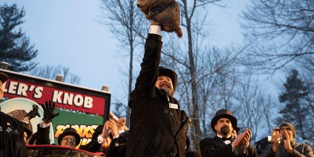 Groundhog Club co-handler Al Dereume holds Punxsutawney Phil, the weather prognosticating groundhog, during the 134th celebration of Groundhog Day on Gobbler's Knob in Punxsutawney, Pa. Sunday, Feb. 2, 2020.
