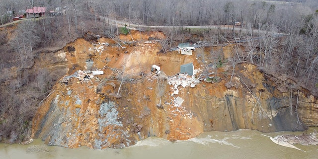 Two homes collapsed into the rain-swollen Tennessee River, the Hardin County Fire Department reported. Homeowners were evacuated from the first house and the second home was unoccupied, officials said. (Hardin County Fire Department)