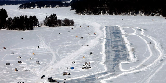 In this Feb. 28, 2015, file photo, planes are parked after landing on a frozen Lake Winnipesaukee in Alton, N.H.