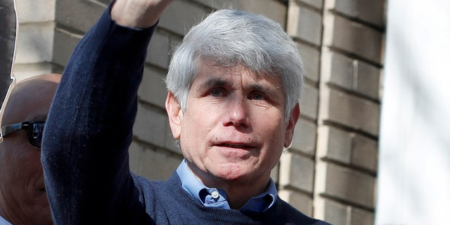 Former Illinois Gov. Rod Blagojevich and his wife Patti wave to supporters after a news conference outside his home Wednesday, Feb. 19, 2020, in Chicago. On Tuesday, President Donald Trump commuted his 14-year prison sentence for political corruption. (AP Photo/Charles Rex Arbogast)