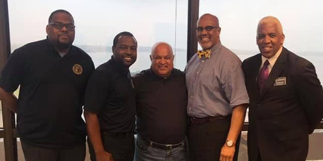 Pictured left to right: Cary Chavis (community relations, Impact Agency); Braylon Harris (director of Impact Agency); Dennis Naicker (pastor of Trinity Ministries from South Africa); Eric Doshier (recruitment coordinator of Impact Agency); and Ronald Blanchard (education coordinator for Impact Agency).