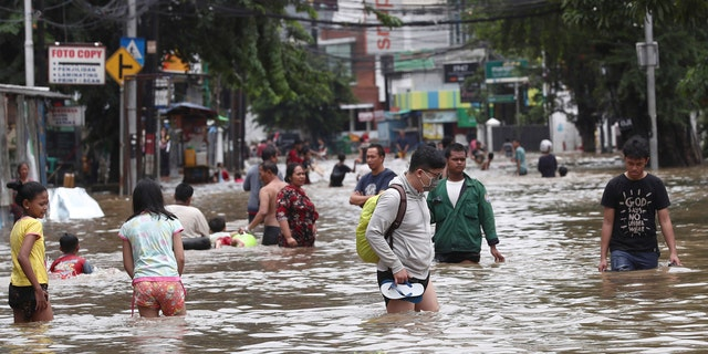 Overnight rains caused rivers to burst their banks in greater Jakarta sending muddy water into residential and commercial areas, inundating thousands of homes and paralyzing parts of the city's transport networks, officials said.