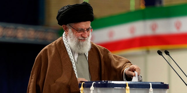 Iranian Supreme Leader Ayatollah Ali Khamenei casts his ballot in the parliamentary elections, in Tehran, Iran, on Friday. (AP/Office of the Iranian Supreme Leader)