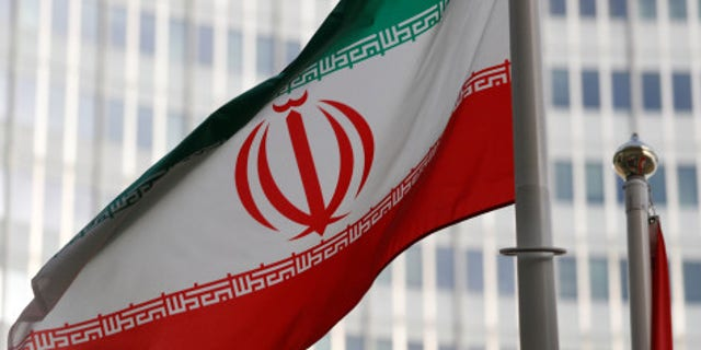 The Iranian flag flutters in front of the International Atomic Energy Agency (IAEA) headquarters in Vienna, Austria.